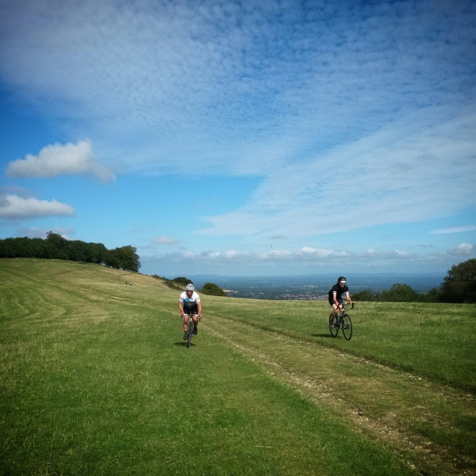 Nigel and George grasstracking down from Chanctonbury Ring.