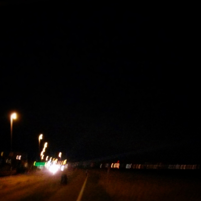 Cycle path out of Worthing and I can see the lights of home along the coast.